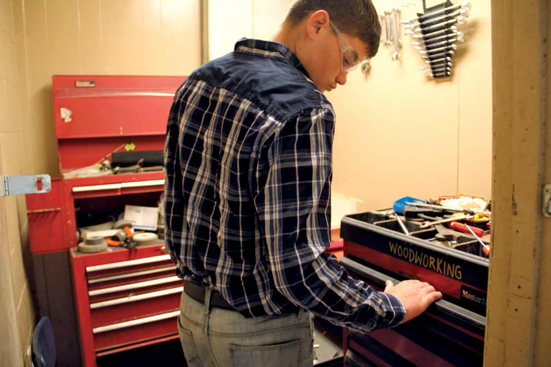 Photo of student using tools donated by Mr. Embry