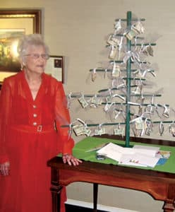Mamie next to her money tree